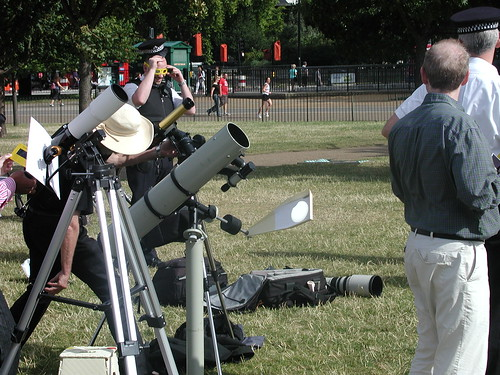 Astronomers in Hyde park, London watch an eclipse