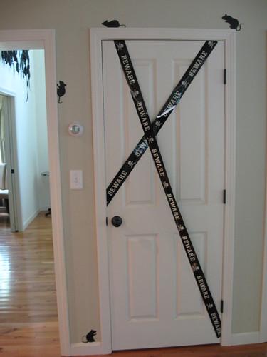basement door & halloween decorations: DO NOT ENTER door   sincerely yours dena