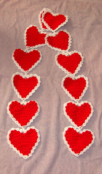 Crocheted heart scarf ~ cool idea for decorating a classroom, maybe?
