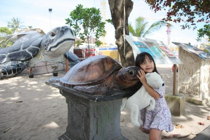 aina loves the smaller tortoise :)