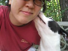 Domino gives a volunteer a kiss (actually an ear lick)