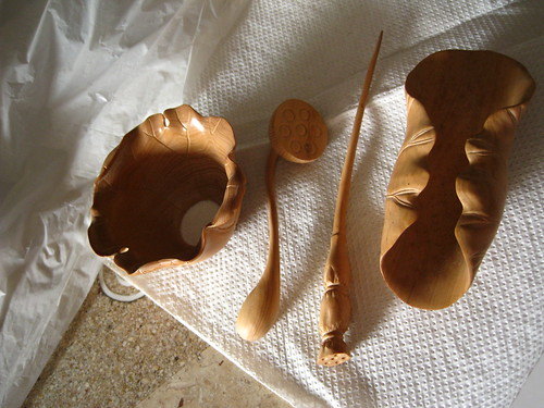 Set of carved wooden implements for the Chinese tea ceremony designed with a lotus theme.