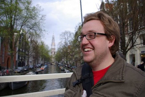 Pete Talor next to a canal in Amsterdam