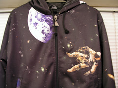 The earth and an astronaut on the front of my cool new hoodie - it has the Atlantis Space Shuttle on the back