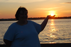 Michele holding the sun