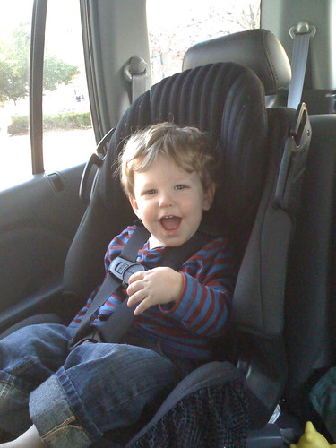 Alex having fun in his car seat