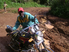 Maurices moto gets stuck in the mud on our way to the village. I hopped off to take this shot.