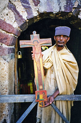 Abbot with cross bearing image of Jesus, Ancient Orthadox monistary, Lake Tana, Ethiopia