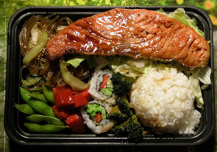 Salmon, rice, broccoli, carrots, broccoli-carrot sushi, japchae, edamame, and salad