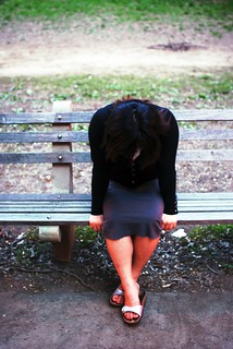 Crying girl on bench