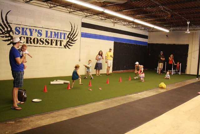 Kids and families having fun at the gym grand opening