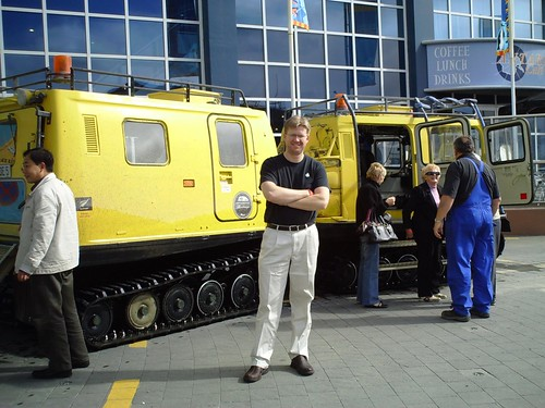 By one of the Hagglund Antarctic Vehicle vehicles at the Christchurch Antarctic Center
