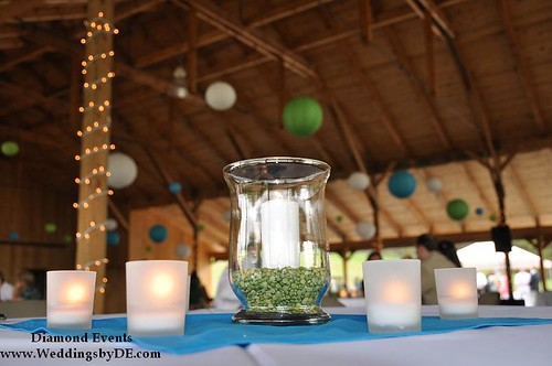 Candle centerpieces and lanterns in the backgrond