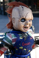 creepy Chucky doll lashed to a bike