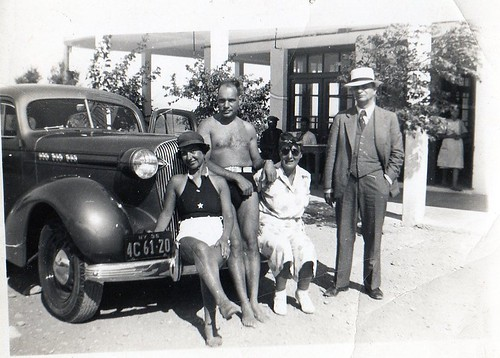 In this photo, the car bears US license plates. Was it taken in the States or in Greece just after its arrival? Manolis is in his bathing suit. It could be in Loutraki.