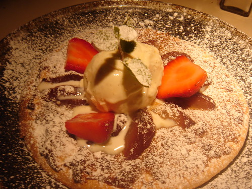 Red wine poached pear pizza, caramel base topped with vanilla ice cream