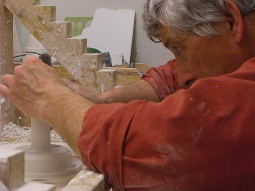 Taking a little off the top - Koen de Winter making a positive from plaster on the wheel to make a slip casting mold.