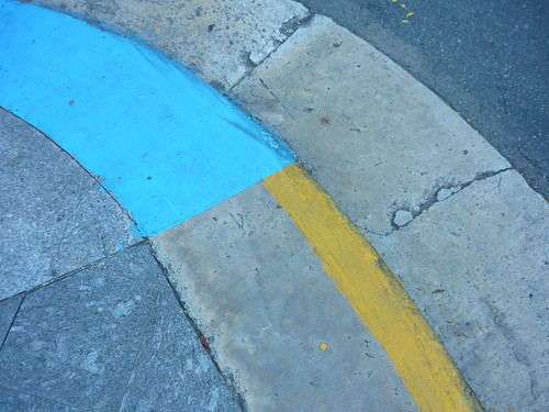 The pavement in San Juan is blue for wheelchair crossings, yellow for illegal to park