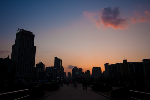 The sun sets over Seoul, as seen from Olympic Park.