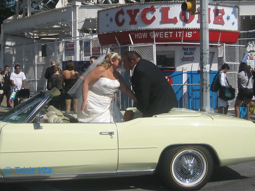 The newlyweds stopped traffic on 10th Street while they kissed. Photo © Tricia Vita/me-myself-i via flickr