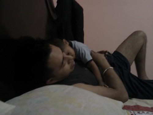 Daddy putting Kai to sleep