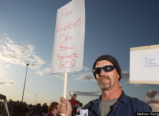 """Republican """"tea party"""" protester's sign says 'Real Americans Only! Bow Before GOD'"""