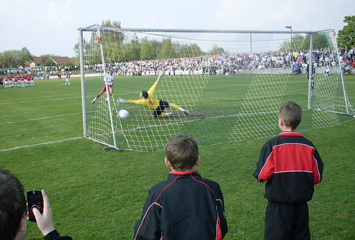 Mackie hits the winning penalty