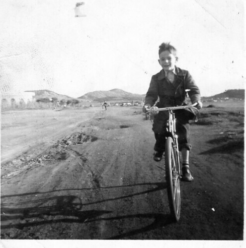 Byron on his first Bauer bicycle-ca.1957 in Voula. In this early picture the seaside road was not as yet constucted! Visible is the rounded Hotel Akroyiali building. An ideal bicycling arena were the salt flats of Voula.
