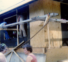 Joan and Eve chatting outside house being built