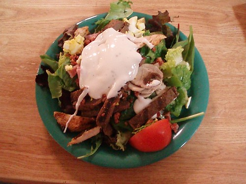 Salad w/ chicken, beef, spinach, lettuce, tomato, egg, onions, and blue cheese dressing
