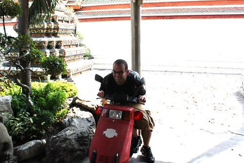 On Bike in Wat