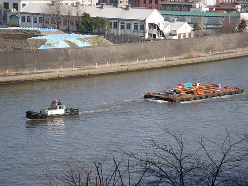 A barge being towed on the Sumida river, Tokyo