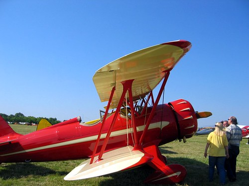 Red biplane.