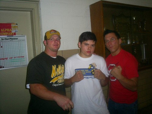 Brandon Aarons (center) has trained with Dingo since July 2006, which has helped him advance his career. Aarons and Dingo are pictured with A.J. Styles from when Aarons began training. Photo courtesy of Brandon Aarons