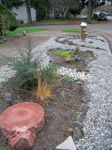 Parking strip rock garden beds
