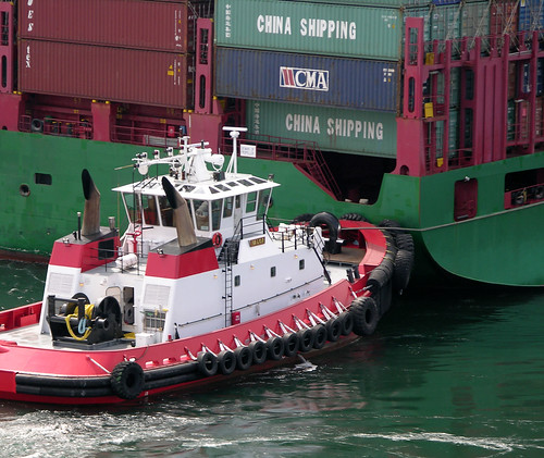 Big container ship (little tug boat)