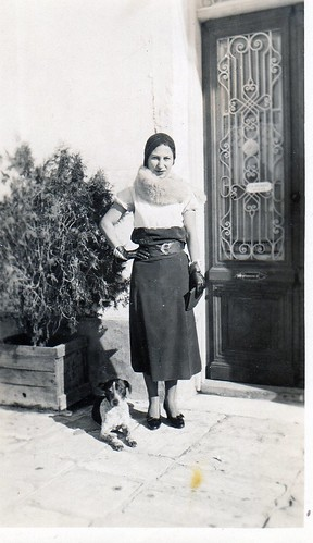 Here Pitsa as a young maiden, fashionably dressed in front of the family house door in Vathy, Samos, ca. 1928.
