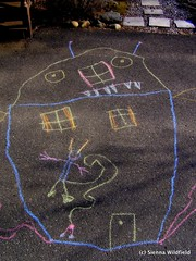 Kids get inspired by the spring thaw and a few stalks of sidewalk chalk. (Photo credit: Sienna Wildfield)