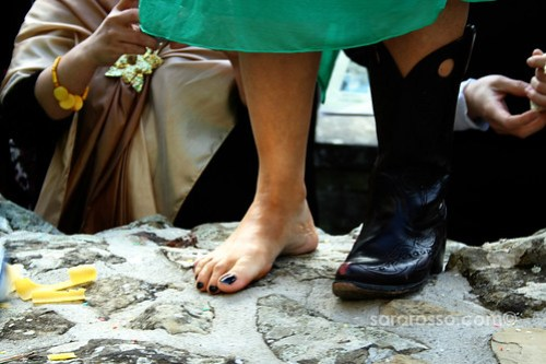 Pasta, cowboy shoes and bare feet at an Italian wedding