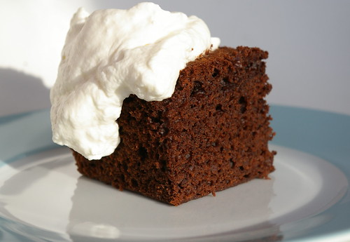 Chocolate cake topped with whipped cream