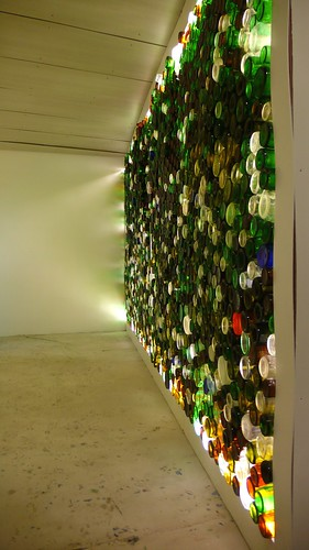 A wall of empty liquor bottles, constructed by local designers and architects.  A comment on the end of glass recycling in Anchorage.  At International Gallery.