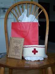 Thats a nursing maual from 1910 and a hand knit, felted nurses hat.