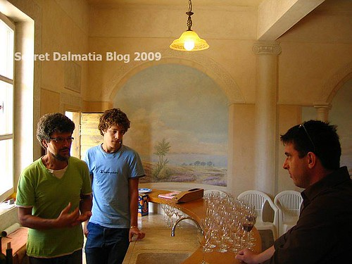 Frano and his son in the wine tasting room