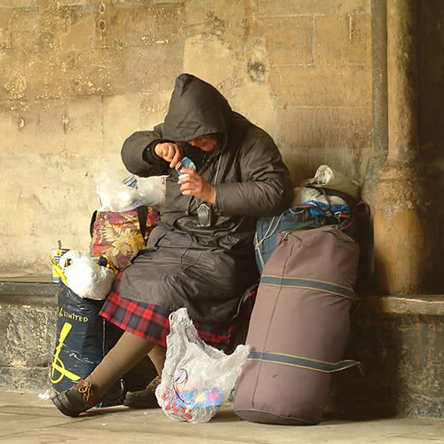 A homeless woman eats dinner, an orphaned image from Living the Scientific Life