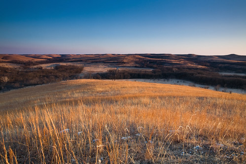 As the Sun sets, the remaining light graces the prairie with a fantastic show of golden light. by you.