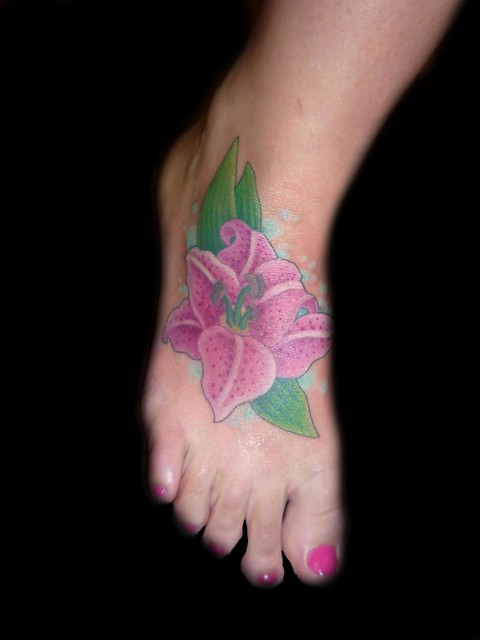 lilly flower tattoo on foot. This lilly tattoo was done by christina walker