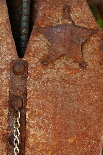 Rusted Metal Statue with Star Badge