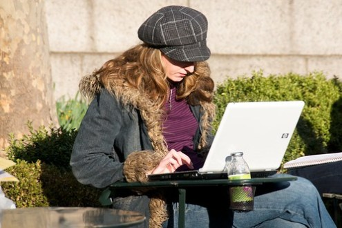 One of the rare non-Apple laptops seen in an otherwise cool park full of cool people