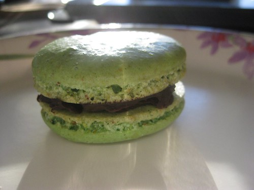 Pistachio macaron with ginger chocolate ganache