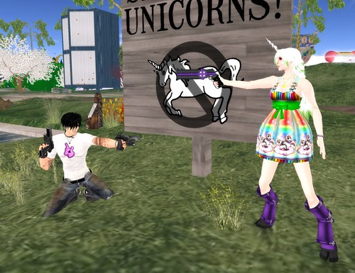 The Anti-Unicorn Gecko Gorilla and Katat0nik-clad Adaire DeCuir stand off in front of a propaganda sign decrying the arrival of the unicorns.